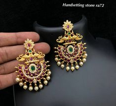 Beautiful chaandbali style earrings with dancing peacock design. Earring studded with white and pink and green color stones. Earrings with bead hangings. Gold Jhumka Earrings, Indian Jewelry Earrings, Jewelry Design Earrings, Gold Earrings Designs, Gold Jewellery Design, Gold Jewelry, Beaded Jewelry, Peacock Earrings, Glass Jewelry