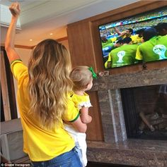 Support: Back home in America, Gisele Bundchen showed her own support by wearing a jersey ...
