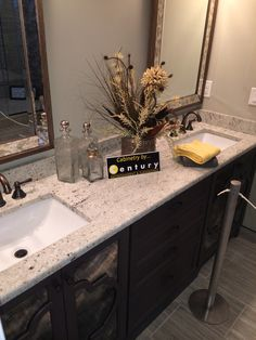 Colonial White granite with dark vanity. Visit globalgranite.com for your natural stone needs.