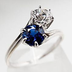 I LOVE this design idea. Could be used for the couple's birthstones. -Antique Twin Blue Sapphire & Diamond Engagement Ring 18K White Gold, $1440.00