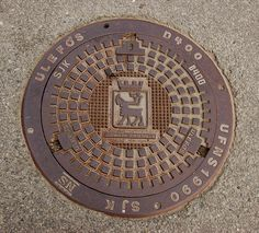 Manhole cover, Tromso, Norway (by ccotton)