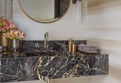 Penthouse bathroom in black marble and edgy mixed metals: North Knightsbridge