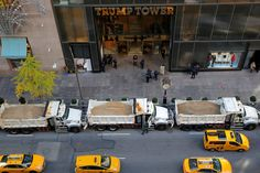 Why Trump and Clinton's locations are surrounded with dump trucks full of sand