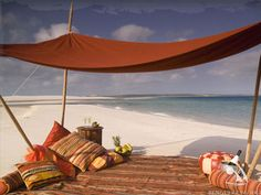 Mozambique's island lodges create opportunities for romance - dine Bedouin-style at Benguerra Lodge, within the Bazaruto Archipelago, a chain of tropical islands, off of southern Mozambique. Picnic Spot, Beach Picnic, Picnic Time, Honeymoon Getaways, Dream Vacations, Places To Travel, Places To See, Mozambique Beaches, Surf