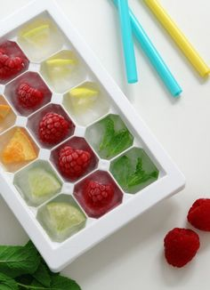 Fruit Ice Cubes.  Use raspberries, mint, lemon and orange wedges to jazz up your ice cubes.  Great way to add extra flavor to summer drinks.  #HealthyEating #CleanEating #ShermanFinancialGroup