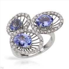 $1,179.00  Spectacular Brand New Cocktail Ring With 3.95ctw Precious Stones - Genuine  Clean Diamonds and Tanzanites Crafted in 14K White Gold. Total item weight 7.9g - Size 7 - Certificate Available.
