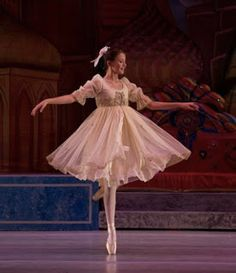 I'm a big fan of when companies use a Clara costume that isn't the typical white-with-a-red-sash and it looks wonderful, just like this one. I love the color, but I especially love the flouncy skirt that this Clara pulls off beautifully. The History of The Nutcracker | World Ballet Inc.