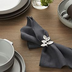 Handcrafted with an intricate botanical motif, this tasteful sprig of textured, nickel-plated brass is a natural table accent any time of year. Linens And More, My Ideal Home, Egg Holder, Gold Wood, Wood Crates, Cloth Napkins, Crate And Barrel, Napkin Rings, Flora
