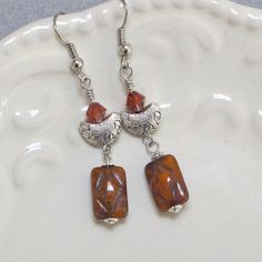 UU Chalice Jewelry — Earrings with Red Magma Swarovski Crystal, Tibetan Silver and Czech Glass, by jUUwelry on Etsy