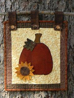 Boiled Wool Pumpkin with Sunflower Hand Stitched onto a Quilted Wall Hanging Wool Applique Patterns, Fall Patterns, Applique Quilts, Hand Applique, Quilt Patterns, Fall Sewing Projects, Quilting Projects, Small Quilts, Mini Quilts