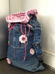 Childs gingham lined recycled jeans denim back pack. Crochet flower and wooden bead detail.