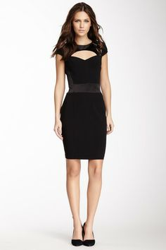 The neckline is interesting, and I just love black dresses. This one reminds me of a Disney villain or something.  -A