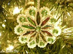 "Handmade beaded/crocheted ornament that my mother in law made...she made hundreds of these and all were really different from one another. I have about ten or so but wish I had more. As she used to always say ""they'll be heirlooms someday""...yes in deed they are!"