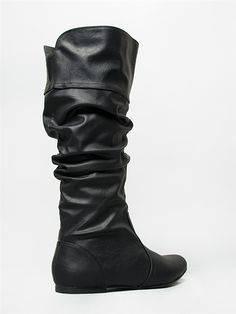 - Take your pick from plush velvet or fine leatherette, these boots come in two different materials and go with everything in your closet! - High boots feature a slim low heel and stitched panel detai