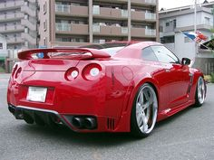 Nissan GT-R its a little red; but look at those wheels http://extreme-modified.com/