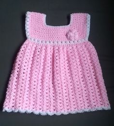 Ravelry: Baby/Toddler Dress pattern by Nichole Magnuson  This dress is made with DK weight yarn and a 5mm hook for a loose, comfy stitch.