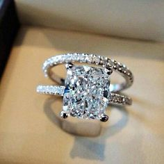 Perfect Wedding Ring! Love the rectangular diamond with a band of little…