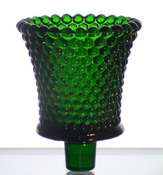 Home Interiors Peg Votive Holder Dark Emerald Green Hobnail  Hobnail pattern like raised dots define the appearance of this pretty holder. This holder is a vintage one, and getting harder to find. Rare Color: Dark Emerald Green  Brand: Homco / Home Interiors Height: 3.5 inches, including stem Width: 2.875 inches Material: Glass