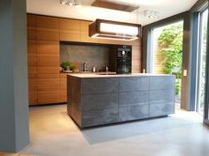 """A kitchen made with Slate-Lite, the paperthin real stone veneer. Used decor: """"NEGRO"""". Exterior Design, Interior And Exterior, Real Stone Veneer, Design 3d, Stone Panels, Luxury Interior Design, Kitchen Interior, Slate, Furniture"""