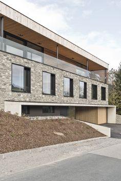Modernes Haus_Steinfassade_Österreich Garage Doors, Outdoor Decor, Home Decor, Stone Facade, House, Decoration Home, Room Decor, Home Interior Design, Carriage Doors