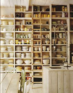 Floor to ceiling shelves work in any space, even one row will do- if limited wall space. A rolling ladder adds soul and practicality ..layer in books, pottery, art...make them your own.