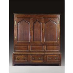 A CUPBOARD ON CHEST,  GEORGE II,SECOND QUARTER 18TH CENTURY, WALES oak, in two parts, the pair of doors now enclosing shelves