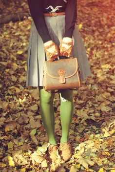 Leather gloves with bows and striking green tights