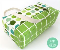 """TRY: """"Sew4Home shares a tutorial for making a boxy duffle perfect for weekend trips or going to the gym.  It's a good sized bag with angled pockets on the sides to hold your phone, keys, or other small items.  There's plenty of room inside for a change of clothes.  Finished measurements are approximately 20″ wide x 11″ high x 7″ deep."""""""