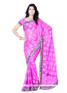 Hot pink jacquard designer saree designed with patch border work. Comes with matching blouse.(Slight variation in color, fabric & work is possible. Model images are only representative.)...