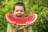 Kid eating watermelon