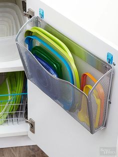 A wall file mounted to a cabinet door is an easy solution for separating plastic lids from bases