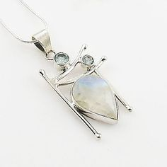 Blue Topaz & Moonstone Sterling Silver artisan crafted Pendant. DETAILS: * Blue Topaz & Moonstone Sterling Silver Pendant * 6.8 g total weight * Set in SOLID .925 Sterling Silver * Stamped 925 * Measu