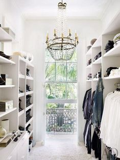 {White closet with chandelier}