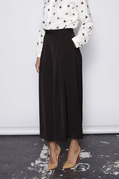 Description: Wide leg culottes in a lovely heavy fluid fabric perfect for winter. Featuring side zip, button fastening and two side pockets. These are a great a
