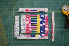 Have you seen those totally adorable quilted projects that people are  making? I don't know about you, but I'm seeing zipper pouches, wallets,  pillows, purses, and you-name-it all over the web and in my instagram feed  that are made with QAYG (quilt as you go) fabric.