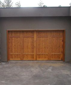 Wood board and batten stained shutters with metal bolts for Garage sprint auto stains