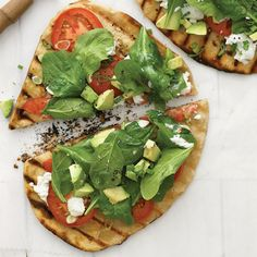 West Coast Grilled Pizza topped with fresh basil, tomatoes, avocado & goat cheese! Yummmmmm!