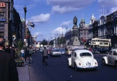Dublin is the capital and largest city of Ireland, and in the province of Leinster on Ireland's east coast, at the mouth of the River Liffey. Irish Free State, The Province, Dublin Ireland, East Coast, Old Photos, 1960s, Street View, Scene, River