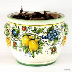 The Italian Mastri-Ceramisti, who have spent the last five centuries perfecting the tin-glazed earthenware that is today called Majolica. This product was created using the Ingobbio technique, the ancient Tuscan process that gives such an authentic Old World look.  Due to the complexity of both preparation and painting, this technique is now used by very few artisans, which makes these items very hard to find. Hand-made by master artisans from Tuscany.