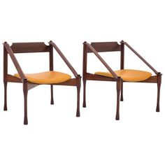 Distinctive Pair of Rosewood and Leather Armchairs by Claudio Salocchi, 1960 | 1stdibs.com