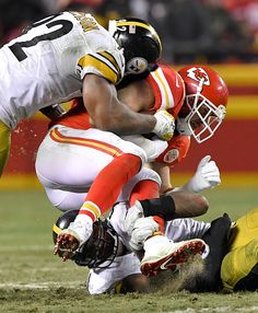 Kansas City Chiefs tight end Travis Kelce is sandwiched between Pittsburgh  Steelers outside linebacker James Harrison and inside linebacker Lawrence. 954fbb1e8be