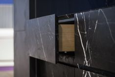 https://flic.kr/p/pnjEPZ | piqu @100% Design 2014 | Full stone fronted drawers, with thanks to Stone Interiors. Acid etched nero marquina marble.