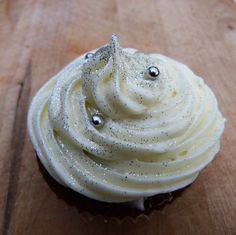 White cupcakes with silver glitter or even edible silver or gold star sprinkles