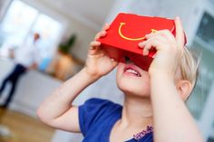McDonald's Sweden has launched a promotion that lets kids turn Happy Meal boxes into virtual-reality viewers. The launch of Happy Goggles coincides with the Swedish . Virtual Reality Goggles, Virtual Reality Headset, Le Happy, Happy Meal Box, 3d Foto, Smart Packaging, Android, Jackett, Box