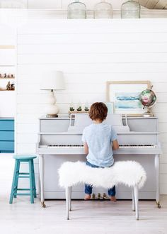 A secondhand piano customized with grey paint. Love the pop of a turquoise stool abd dresser in the background {PHOTO: Barry Calhoun}