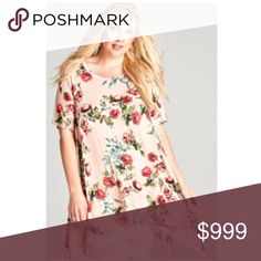 """(Plus) Floral sharkbite tunic 95% rayon/ 5% spandex. So soft! Very stretchy and flowy. Runs slightly large- I'm a 2x/16/18 and the 1x fit really well. I would say 1x = 14/16, 2x = 16/18, 3x = 18/20. Sharkbite hem- measurement is shortest/ longest points.  1x: L 32/39"""" B 40"""" 2x: L 33/40"""" B 42""""  3x: L 34/41"""" B 44"""" ⭐️This item is brand new from manufacturer without tags.  🚫NO TRADES 💲Price is firm unless bundled 💰Ask about bundle discounts Availability: 1x•2x•3x • 2•2•2 Tops Tunics"""