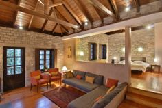 rustic and inviting. love lighting the ceiling. Rustic Stone, Stone Houses, Corfu, Great Rooms, Mountain Resort, Greece, Sweet Home, Interior Design, House Styles