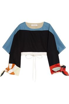 """Clare Waight Keller describes Chloé's 'Urban Innocence' collection as """"a play of boyish attitude and romantic details."""" This cropped runway top is made from panels of sky-blue, navy and mustard cotton-twill and has billowy sleeves with exaggerated tie-fastening cuffs. Adjust the fit using the drawstring waist, styling it with the matching skirt."""