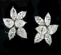 Giuliana Rancic wore these 13 cts. t.w. diamond cluster earrings to the 84th Academy Awards   Cluster earrings in platinum have 13 cts. t.w. diamonds; $120,000. Norman Silverman