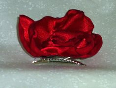 This brooch/lapel pin/hair clip would make a great mother's day gift! The fabric has a very pretty sparkle woven into it.